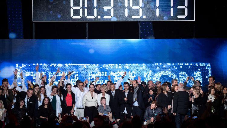 La trentième édition du Téléthon a permis de récolter plus de 80 millions d'euros de promesses de dons. (PHILIPPE LOPEZ / AFP)