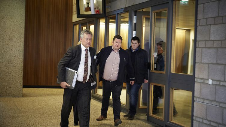 Le négociant en viandenéerlandais Willy Selten (au centre), le 16 avril 2013 au tribunal de La Haye (Pays-Bas). (MARTIJN BEEKMAN / ANP / AFP)