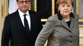 Le président français, François Hollande, et la chancelière allemande, Angela Merkel, à Kiev (Ukraine), le 5 février 2015. (SERGEI SUPINSKY / AFP)
