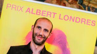 Philippe Pujol, lauréat du prix Albert-Londres 2014 dans la catégorie presse écrite, le 12 mai 2014 (THIBAUD MORITZ / MAXPPP)
