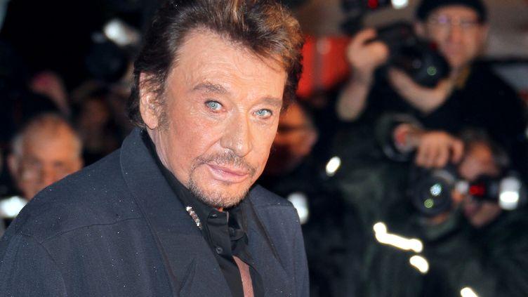 Johnny Hallyday, le 28 janvier 2012 à Cannes, lors de la cérémonie des NRJ Music Awards. (VALERY HACHE / AFP)
