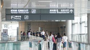 Des voyageurs à l'aéroport de Nanjing, le 29 juillet 2020 en Chine. (JI CHUNPENG / XINHUA)