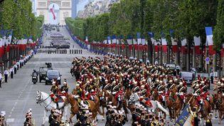 La parade du 14-Juillet en 2012, aux Champs-Elysées, à Paris. (BERTRAND GUAY / AFP)
