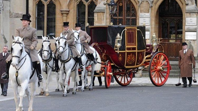 Le carrosse a participé à la répétition du cortège royal mercredi soir (AFP - Carl Court)