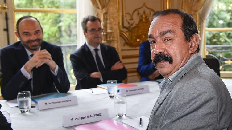 Le secrétaire général de la CGT, Philippe Martinez, lors d'une réunion à Matignon avec le Premier ministre, Édouard Philippe, le 24 juillet à Paris. (BERTRAND GUAY / AFP)