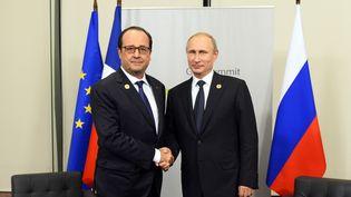 François Hollande et Vladimir Poutine à Brisbane (Australie), le 15 novembre 2014. (ALAIN JOCARD / POOL)