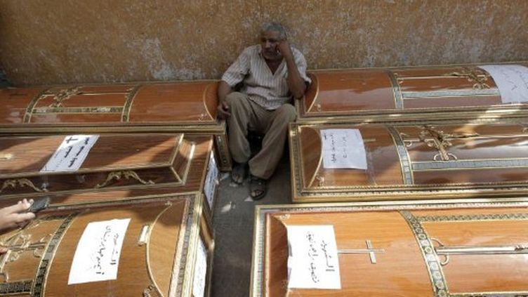 Victimes coptes en Egypte suite aux violences de dimanche soir. (MAHMUD HAMS / AFP)