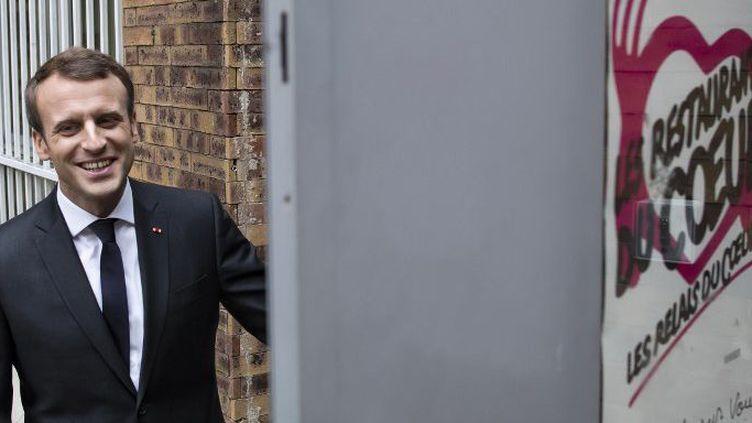 Emmanuel Macron au lancement de la 33e campagne hivernale des Restos du cœur (IAN LANGSDON / POOL / AFP)