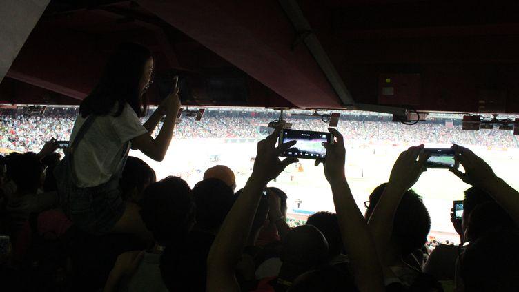 Le public chinois est venu en masse dans le Nid d'oiseau pour assister à la finale du 100m