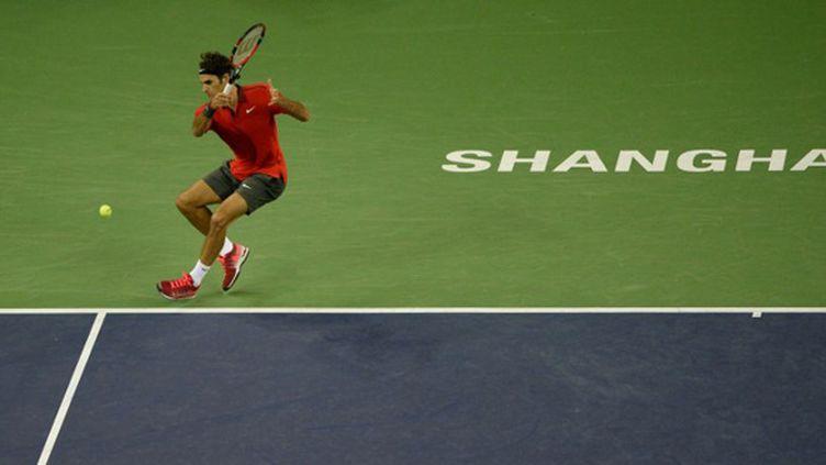 Roger Federer a livré un récital pour dominer Novak Djokovic (Shanghai 2014) (JIA RU / AFP)