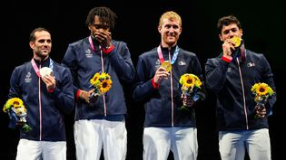 L'équipe de France de fleuret a été sacrée championne olympique à Tokyo dimanche 1er août 2021. (VLADIMIR PESNYA / SPUTNIK / AFP)