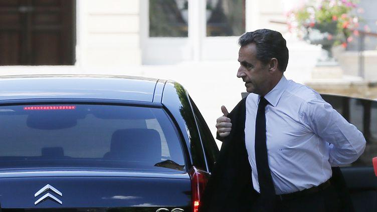 L'ancien président de la République, Nicolas Sarkozy, arrive à l'Assemblée nationale pour y recevoir une distinction, le 25 juin 2014. (GONZALO FUENTES / REUTERS)