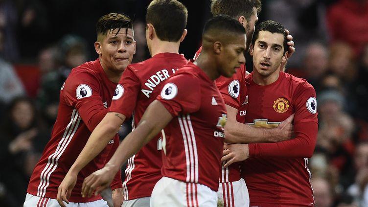 Les joueurs de Manchester United (OLI SCARFF / AFP)