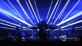 Le DJ français Pascal Arbez-Nicolas, alias Vitalic, sur scène.  (ALAIN JOCARD / AFP)